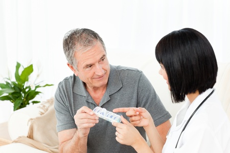 Nurse helping her patient to do exercises at home Stock Photo - 10175563