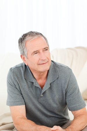 Mature man with his walking stick on his bed at home Stock Photo - 10175567