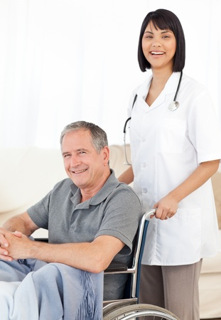 Nurse with her patient looking at the camera Stock Photo - 10175096