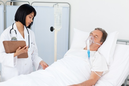 Nurse whith her mature patient in a hospital Stock Photo - 10164093