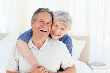 Senior couple looking at the camera  at home photo
