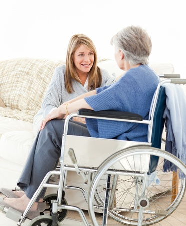 Seniors talking together in the livingroom Stock Photo - 10175710