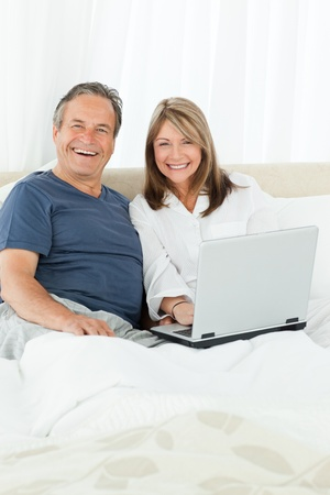 Couple looking at the camera at home photo
