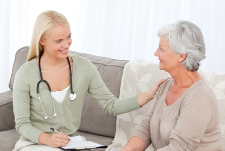 practitioner: Doctor talking with her patient
