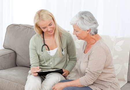 care at home: Doctor talking with her patient
