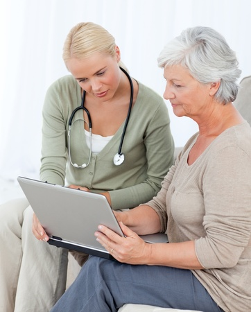 Senior with her doctor working on the laptop Stock Photo - 10173800