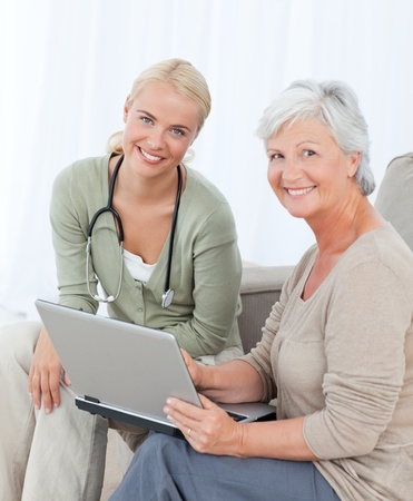 Senior with her doctor working on the laptop Stock Photo - 10172191