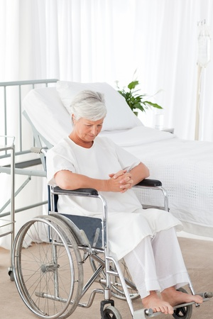 Wonderful nurse and her mature patient looking at the camera photo