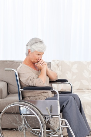 wheelchair users: Woman looking at the camera in her wheelchair Stock Photo