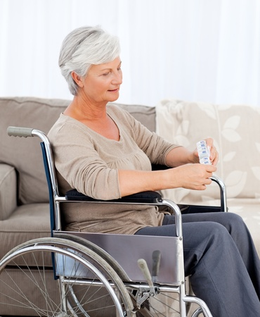 paraplegia: Woman looking at the camera in her wheelchair Stock Photo