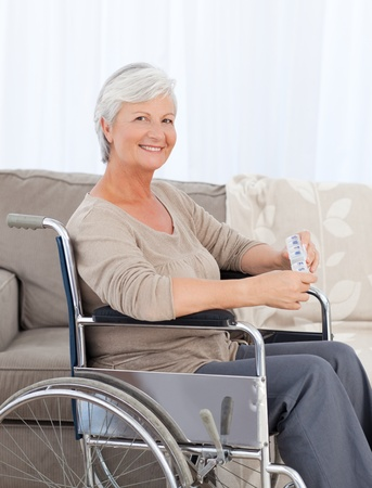 Woman looking at the camera in her wheelchair photo