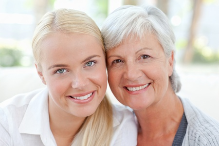 Lovely woman with her mother at home photo