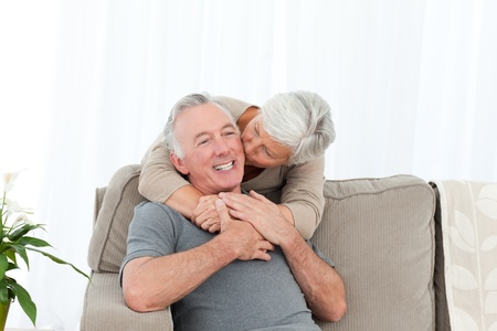 Lovers hugging while they are looking at the camera photo