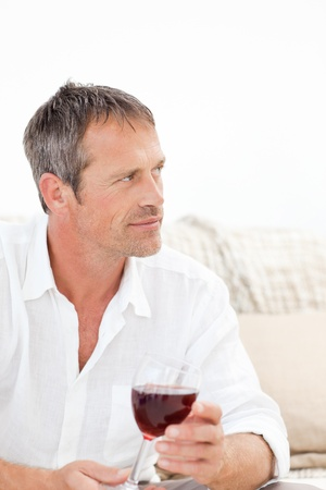 charismatic: Handsome man drinking some red wine at home Stock Photo