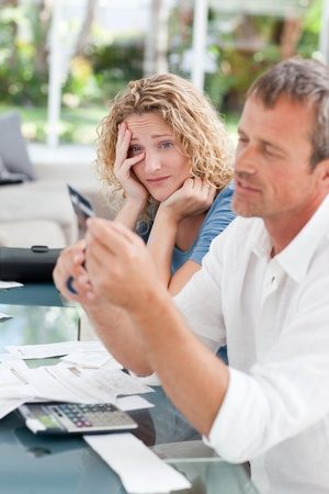Man cutting up his credit card at home Stock Photo - 10171727
