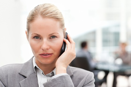 Lovely woman phoning in her office photo