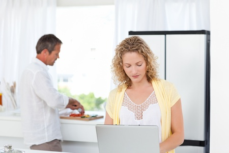 Young couple looking at their laptop at home photo