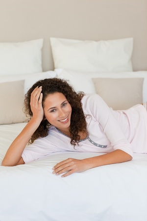 Thoughtful woman with her husband on the bed Stock Photo - 10175296