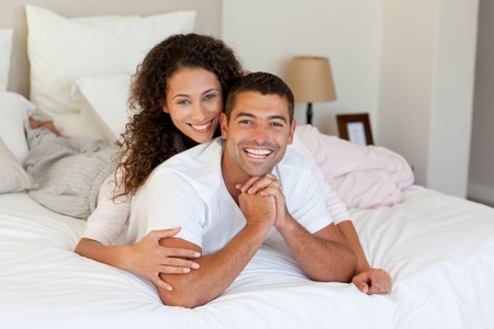 Lovely couple looking at their laptop at home photo
