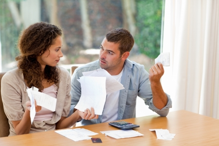 Young couple calculating their domestic bills at home Stock Photo - 10171575