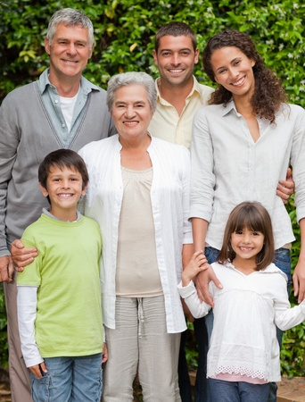 Portrait of a happy family looking at the camera in the garden Stock Photo - 10175522