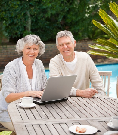 retired couple: Retired couple working on their laptop Stock Photo
