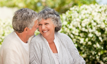 Man kissing his wife in the garden photo