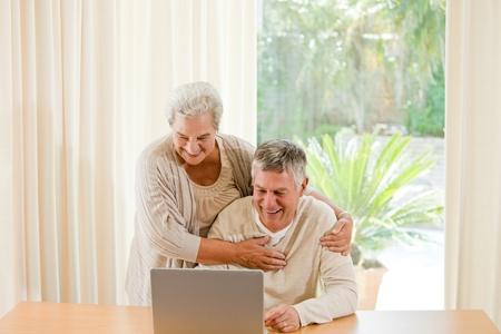 Sad mature couple calculating their domestic bills photo