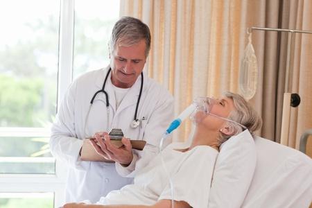 Doctor examining his patient Stock Photo - 10175053