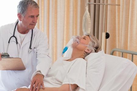 Doctor examining his patient photo