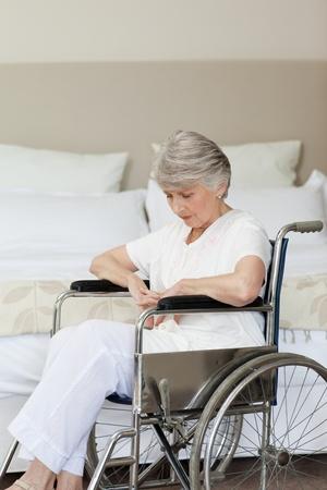 amputation: Senior woman asleep in her wheelchair at home