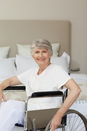 Smiling senior woman in her wheelchair Stock Photo - 10173695