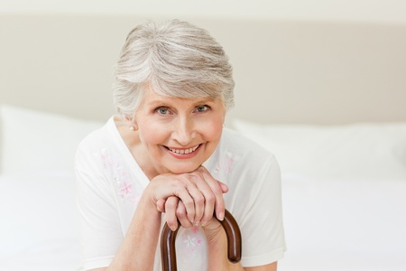 Retired woman with her walking stick  Stock Photo - 10175668