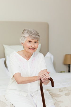 aging woman: Retired woman with her walking stick  Stock Photo