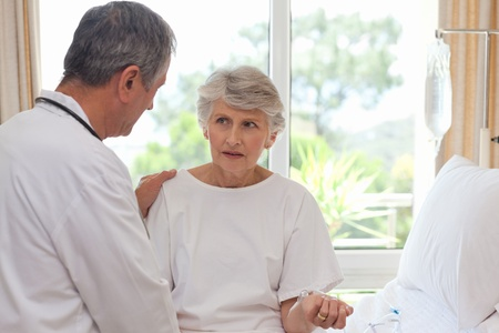 Mature doctor with his patient Stock Photo - 10171573