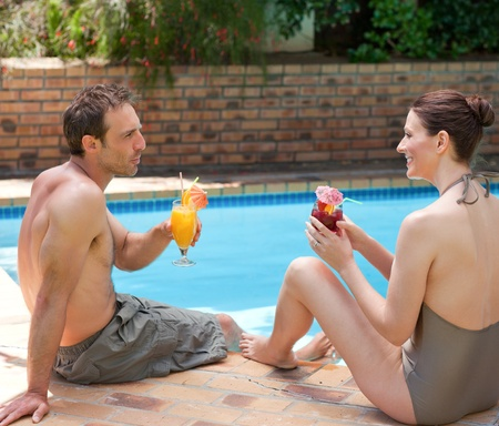 Happy couple drinking cocktails Stock Photo - 10174751