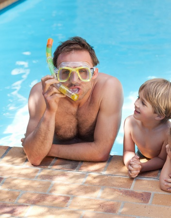 Father with his son in the swimming pool photo