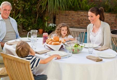 Family eating in the garden Stock Photo - 10175708