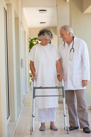 Doctor walking with his patient  photo