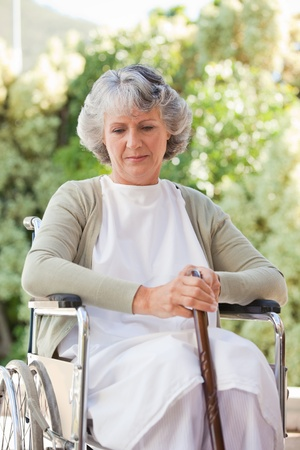 Retired woman with her walking stick Stock Photo - 10172557