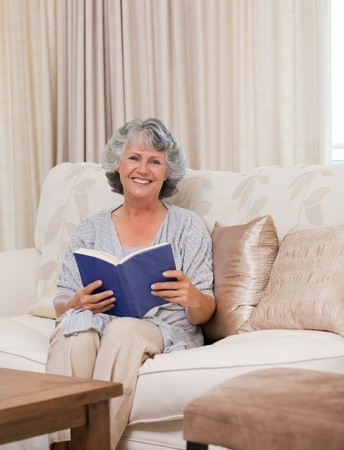 Senior woman reading her book photo