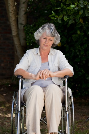 paraplegic: Smiling woman in her wheelchair