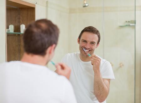 Man brushing his teeth photo