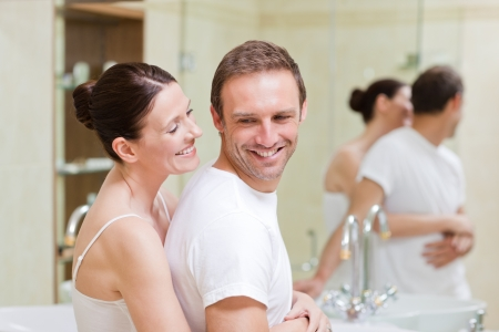 bathroom woman: Couple hugging in the bathroom Stock Photo