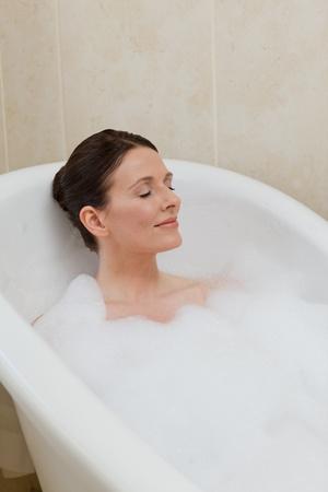 tub: Beautiful woman taking a bath