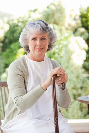 weakness: Retired woman with her walking stick Stock Photo