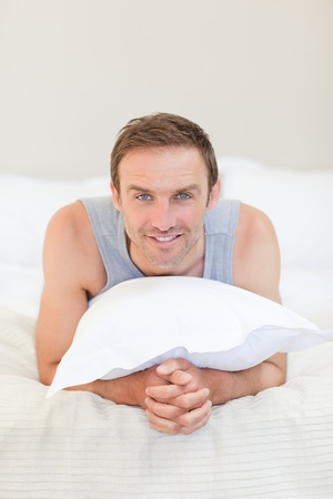 Man lying down on his bed Stock Photo - 10174527