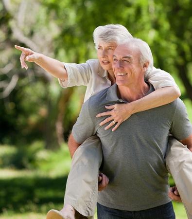 Man giving wife a piggyback photo