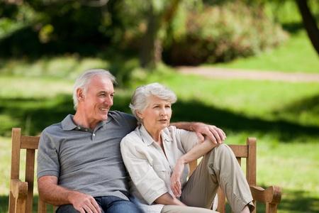 older people: Senior couple sitting on a bench Stock Photo