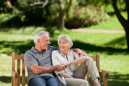 elderly couples: Senior couple sitting on a bench Stock Photo